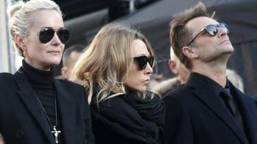 Laeticia Hallyday, Laura Smet et David Hallyday lors des obsèques de Johnny à Paris, le 9 décembre 2017