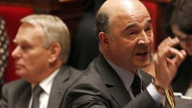 Pierre Moscovici et Jean-Marc Ayrault à l'Assemblée.