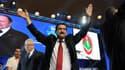 Le grand absent des meetings de campagne de Bouteflika était... Bouteflika lui-même, qui n'apparaît que sur écran géant. Au premier plan, Amar Ghoul, ministre des Transports, crée l'ambiance.