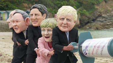 Sommet du G7: des militants d'Oxfam se déguisent en caricatures de chefs d'État sur le thème de la vaccination