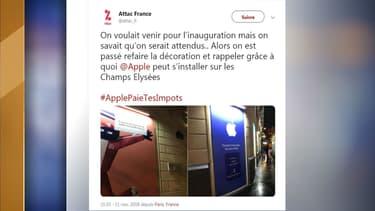 Des militants d'Attac ont mené une action au futur Apple Store des Champs-Elysées.