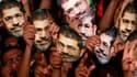 Partisans de Mohamed Morsi et des Frères musulmans lors d'un rassemblement au Caire, vendredi. Une enquête pénale a été ouverte pour espionnage, incitation à la violence et destruction de l'économie à l'encontre du président Mohamed Morsi écarté du pouvoi