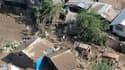 Dans la ville de Cagayan De Oro, dans le sud des Philippines. Les opérations de secours se poursuivaient dimanche pour retrouver plus de 450 disparus après le passage du typhon Washi sur l'île de Mindanao, aux Philippines, qui a tué plus de 500 personnes.