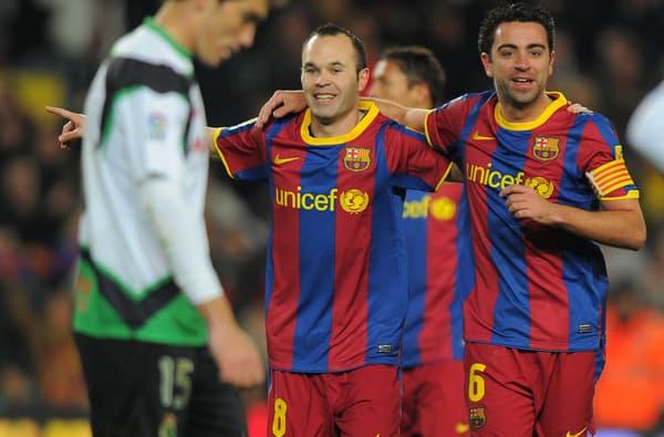 Andres Iniesta (à gauche) et Xavi, le duo plaque tournante du Barça de Pep Guardiola, en janvier 2011