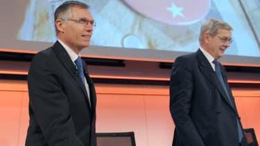 Carlos Tavares (à gauche) succèdera à Philippe Varin (à droite) à la tête du groupe dès le 31 mars.