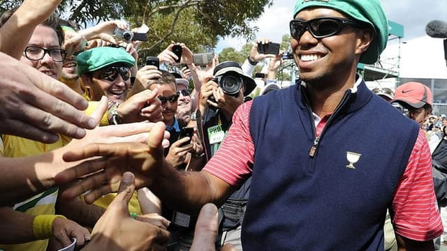 tiger Woods après sa victoire sur Aaron Baddeley