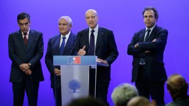 François Fillon, Jean-Pierre Raffarin et Alain Juppé, le 8 juillet 2014, à Paris.