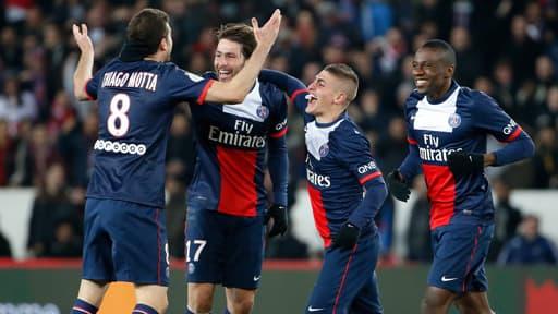 Les joueurs du PSG fêtent un but au Parc des princes le 2 mars 2014.