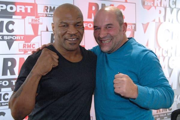 Comme un gosse avec Mike Tyson, en 2013.