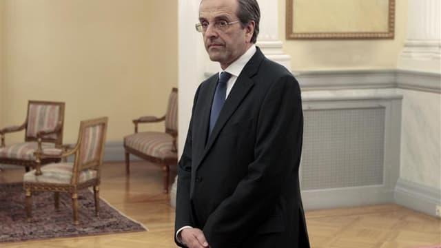 Le nouveau Premier ministre grec, Antonis Samaras, a mis en place jeudi une équipe gouvernementale restreinte avec pour objectif affiché d'obtenir un assouplissement des conditions de renflouement du pays, tout en le maintenant dans la zone euro. /Photo p
