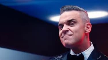 """Robbie Williams dans le clip de son nouveau single, extrait de son prochain album """"Heavy Entertainement Show""""."""