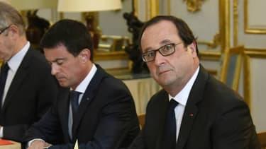 François Hollande, Manuel Valls et Bernard Cazeneuve à l'Elysée le 27 juillet 2016. - BERTRAND GUAY - AFP