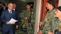 Le Premier ministre Mohamed Ghannouchi, en poste depuis 1999. La Tunisie s'est dotée d'un nouveau gouvernement d'union nationale comprenant trois personnalités d'opposition mais le maintien à leur poste de ministres de Zine Ben Ali risque de heurter les a