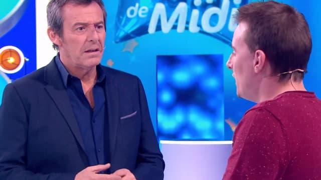Jean-Luc Reichmann, face à Adrien, candidat et ex-paraplégique.