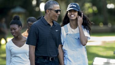 Malia Obama et son père, Barack Obama, à Hawaii en 2016