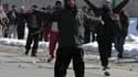 Manifestants chantant des slogans hostiles aux Etats-Unis à Kaboul. Les taliban ont appelé jeudi les Afghans à attaquer les forces étrangères en Afghanistan au troisième jour de manifestations pour dénoncer la profanation d'exemplaires du Coran sur la bas