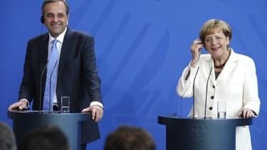 Le Premier ministre grec Antonio Samaras et la chancelière allemande Angela Merkel lors d'une conférence de presse à Berlin, ce 23 septembre.