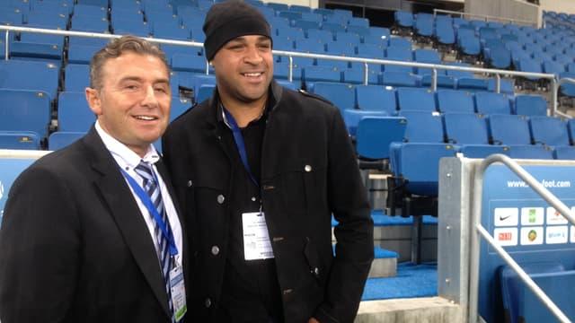 Adriano aux côtés de Christophe Maillol à leur arrivée sur la pelouse du stade Océane