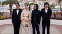 """La réalisatrice japonaise Naomi Kawase et ses acteurs (de gauche à droite) Tetsuya Akikawa, Tohta Komizu et Taiga Komizu, lors de la séance photo pour le film """"Hanezu"""", présenté mercredi à Cannes. Ce long métrage qui concourt pour la Palme d'or représente"""