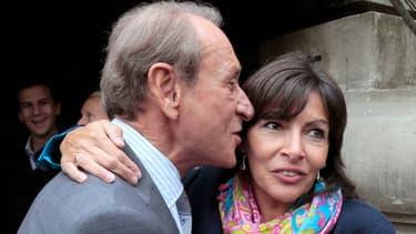 Le maire de Paris (ici à gauche), craint que l'impopularité du gouvernement entraîne la défaite d'Anne Hidalgo.