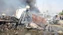 """Des """"attaques terroristes"""" ont fait des dizaines de morts et de blessés jeudi matin dans le sud de Damas, selon la télévision d'Etat syrienne. Des images montraient des dizaines de véhicules calcinés, certains contenant des corps déchiquetés ou mutilés. /"""
