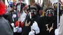 Des participants au carnaval de Dunkerque grimés en noirs en 2010.