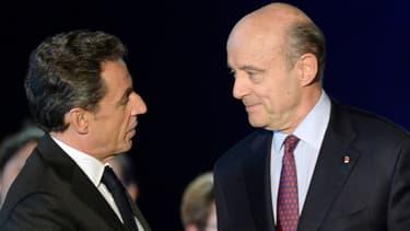 Nicolas Sarkozy et Alain Juppé à Bordeaux, le 22 novembre 2014.