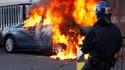 Dans une rue de Birmingham. De nouvelles émeutes ont éclaté mardi soir dans plusieurs villes britanniques au quatrième jour de violences qui ont déjà fait 111 blessés dans les rangs de la police, rapportent des sources policières. /Photo prise le 9 août 2