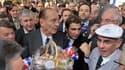 Jacques Chirac a été accueilli mardi en héros par le monde paysan au Salon de l'agriculture, à deux semaines de l'ouverture de son procès dans l'affaire des emplois présumés fictifs de la mairie de Paris. /Photo prise le 22 février 2011/REUTERS/Philippe W