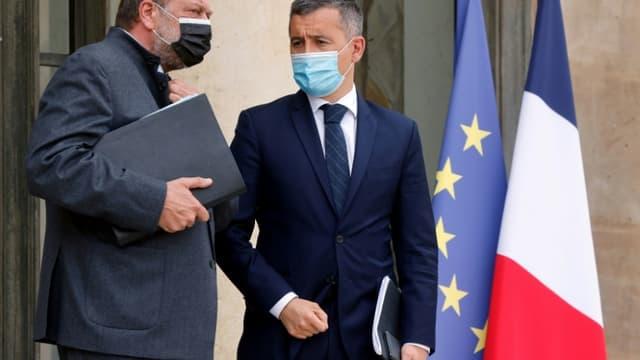 Les ministres de la Justice Eric Dupond-Moretti et de l'Intérieur Gérald Darmanin sur le perron de l'Elysée le 28 avril 2021