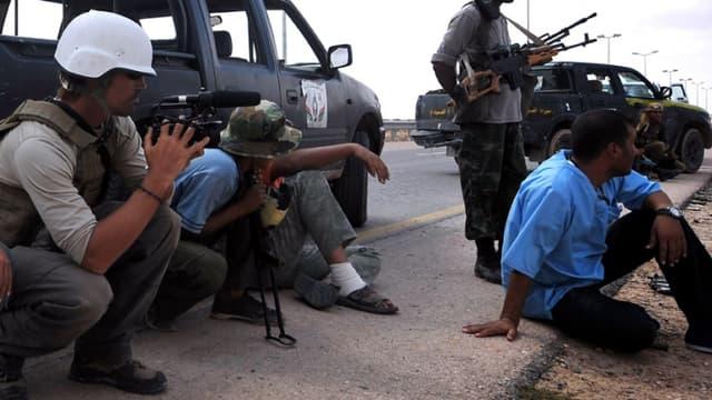 James Foley, journaliste américain tué par l'Etat islamique, en plein travail le 29 septembre 2011. Steven Sotloff est lui aussi menacé de mort par les jihadistes.