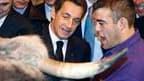 En visite au salon de l'Agriculture, Nicolas Sarkozy a annoncé une augmentation de 800 millions d'euros, pour la porter à 1,8 milliard d'euros, de l'enveloppe de prêts bonifiés destinés à la consolidation des trésorerie des agriculteurs. /Photo prise le 6