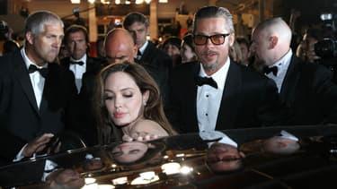 Brad Pii (ici avec son épouse Angelina Jolie lors du Festival de Cannes 2014) donnera le coup d'envoi des 24 Heures du Mans le 18 juin. Il a notamment déjà assisté au Grand prix de Monaco de Formule 1.