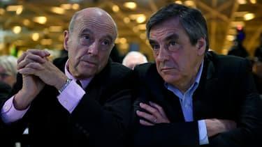 Alain Juppé et François Fillon, les deux finalistes de la primaire à droite, le 13 février 2016 à Paris.