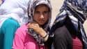 Une jeune Yazidie attend son tour pour recevoir de la nourriture, le 13 août 2014, dans le Kurdistan irakien où elle s'est réfugiée avec sa famille pour fuir l'Etat islamique. (photo d'illustration)