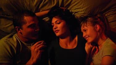 """Aomi Muyock, Karl Glusman, Klara Kristin, les trois héros de """"Love"""", de Gaspar Noé."""