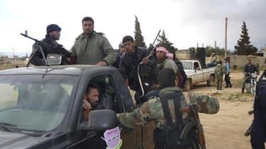 Combattants syriens à Koussaïr, le mois dernier. Les rebelles syriens encerclés à Koussaïr par les forces gouvernementales et des combattants du Hezbollah ont réclamé jeudi une aide militaire et médicale, tandis que Bachar al Assad annonçait avoir pris li