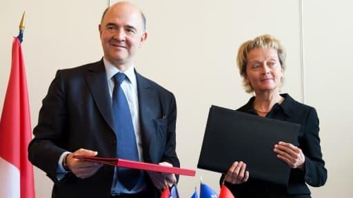 Eveline Widmer-Schlumpf et Pierre Moscovici ont signé jeudi 10 juillet un nouvel accord fiscal sur les successions.