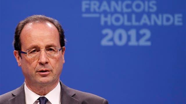 Francois Hollande, en campagne à Paris. S'il avait été aux commandes du pays, François Hollande aurait réagi en président de la même manière que Nicolas Sarkozy après les drames de Toulouse et Montauban revendiqués par Mohamed Merah, estimait-on jeudi en