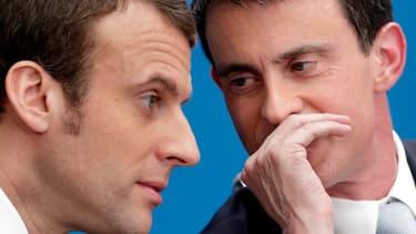Le ministre de l'Economie Emmanuel Macron (gauche) en compagnie du Premier ministre Manuel Valls