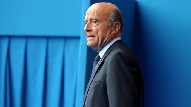 """Le maire de Bordeaux et ancien Premier ministre Alain Juppé sera candidat à la primaire UMP """"même contre Sarkozy""""."""