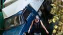 A Krymsk dans la région de Krasnodar. Vladimir Poutine a survolé en hélicoptère la région du sud de la Russie dévastée par des inondations et a ordonné une enquête fédérale pour évaluer la réaction des autorités face à cette catastrophe qui a fait 144 mor