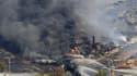 Le déraillement et l'explosion d'un train fou transportant des citernes de pétrole brut a détruit des dizaines de bâtiments et fait au moins un mort samedi à Lac-Mégantic, au Québec, ont annoncé les autorités canadiennes, qui disent redouter un bilan beau