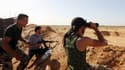 Des miliciens de Farj Libya, coalition qui contrôle Tripoli et combat l'EI en Libye, le 29 avril 2015.