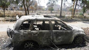 A Homs, lundi. L'opposition syrienne a accusé mardi l'armée gouvernementale d'intensifier ses bombardements sur les quartiers résidentiels de Homs, les autorités de Damas affirmant de leur côté que les rebelles empêchaient l'évacuation de la population ci