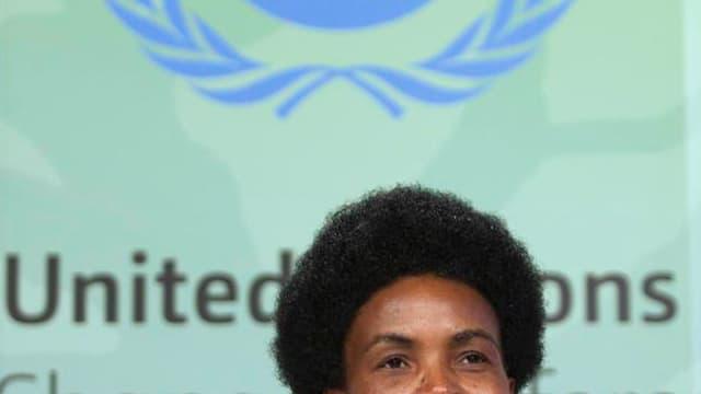 Maite Nkoana-Mashabane, ministre sud-africaine des Affaires étrangères. Les quelque 200 délégations participant à la conférence sur le réchauffement climatique à Durban ont adopté dimanche un pacte qui pour la première fois oblige les plus gros pollueurs