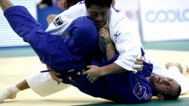 Alain Schmitt (bleu)  lors du dernier tournoi de Chine
