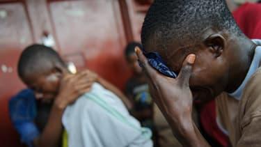Un habitant de Goma pleure la mort de son père tué par les rebelles mardi