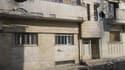 Dans la ville syrienne de Homs, dimanche. La proposition de la Ligue arabe d'accroître le soutien à l'insurrection syrienne et d'envoyer des soldats de maintien de la paix en Syrie a été accueillie avec réserve lundi et n'a pas fait taire les armes à Homs