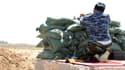 Une milice populaire soutient les troupes régulières iraquiennes, dans la région de Kirkuk, le 8 août 2014.